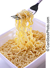 Noodles of fast preparation in a plastic box