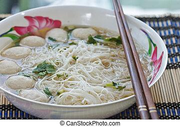 Noodles, pork balls.