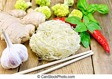Noodles rice with spices and broccoli on the board