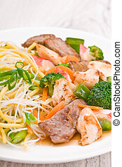 Noodles with Chicken Beef and Crab Stick over bright surface