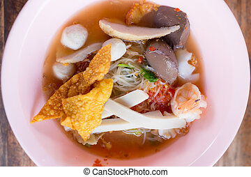 Noodles with seafood soup and red sauce
