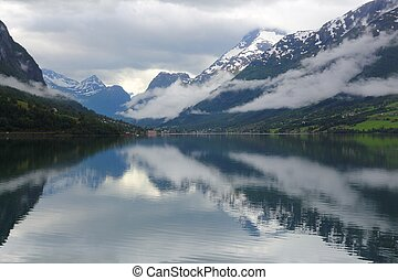 Serene dramatic landscape in Norway - cloudy Nordfjord view in Olden.