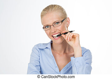 nordic girl chewing a pen