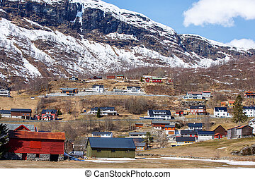 Nordic house in small town with ice cap mountain background