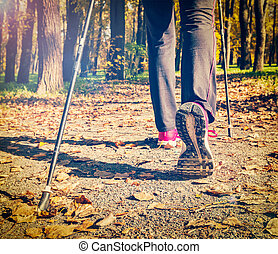 Nordic walking - Close up of hinking woman feet and nordic...