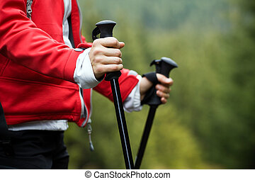 Nordic Walking in Autumn mountains