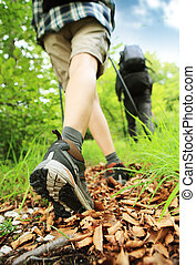 Nordic walking legs in mountains - Woman hiking and nordic...