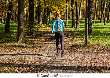 Nordic walking adventure and exercising concept - woman...