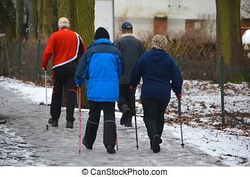Nordic Walking - Seniors while hiking