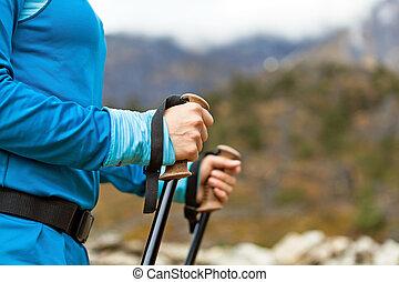 Nordic walking - Young woman hands nordic walking in...