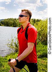 nordic walking - Nordic walking in summer nature.