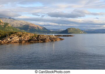 Nordland scenic landscape in Norway. Bindalsfjorden fiord sunset light view.