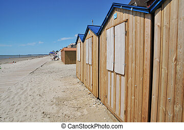 Normandy coast - Normandy beach with wooden cabins