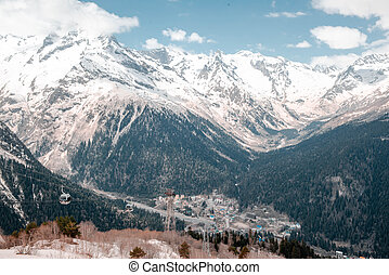 North Caucasus, view of the mountain valley and resort in winter,