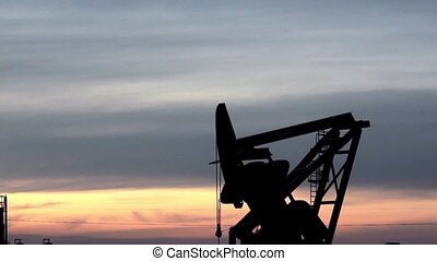 North Dakota Oil Pump Jack Fracking - A device used for oil...