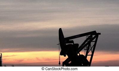 North Dakota Oil Pump Jack Fracking - A device used for oil...