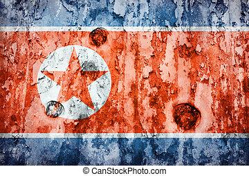 North Korea flag on a weathered grunge background