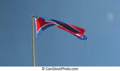 North Korea flag with blue sky