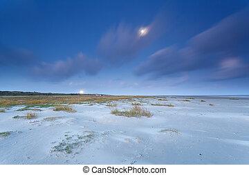 North sea coast in dusk and full moon
