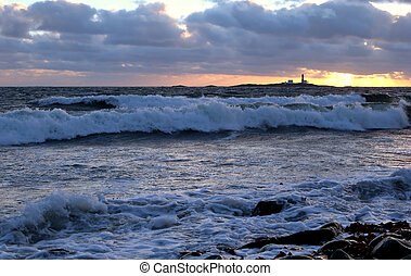 North Sea Sunset - Sunest over distant lighthouse and...