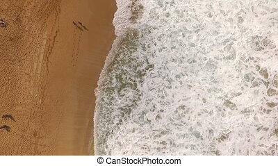 North Shore Couple Walking Sea Shore Hawaii - Aerial view...