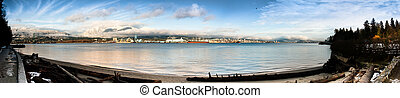 Panorama of North Vancouver industrial shoreline and beach.