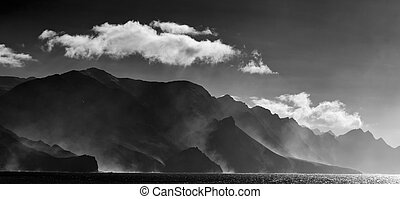 north west of Gran Canaria, cliffs are steaming after rain,...
