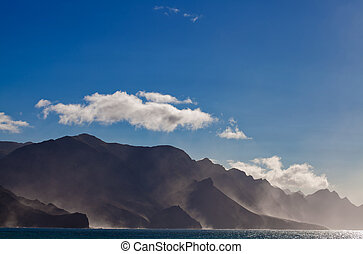 north west of Gran Canaria, cliffs are steaming after rain