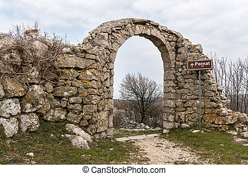 Northern city gate of Lubenice on a cloudy day in spring
