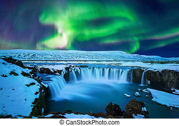 Northern Light, Aurora borealis at Godafoss waterfall in winter Iceland.