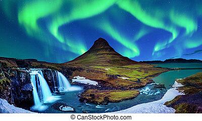 Northern Light, Aurora borealis at Kirkjufell in Iceland. Kirkjufell mountains in winter.