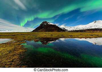 Spectacular aurora borealis near the glacier lagoon Jokulsarlon.