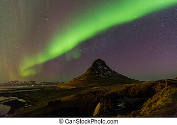 Northern Light over Kirkjufell volcano mountain night view