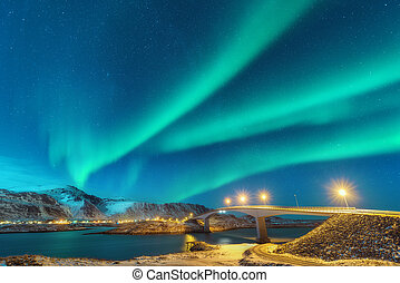 Northern lights above bridge with illumination in Norway