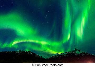 Northern lights (Aurora borealis) at night.