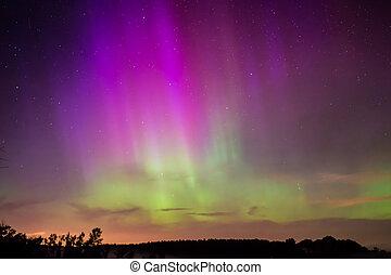 Northern Lights, Aurora Borealis displaying over a lake in...