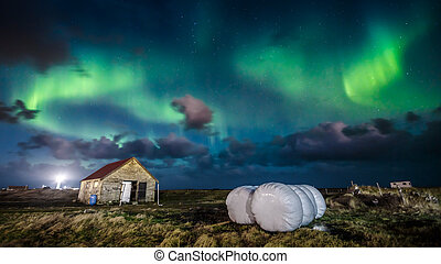 Northern lights (Aurora borealis) over farm house