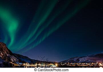 Northern lights (aurora) seen at night at Ersfjordbotn (Troms, Norway).