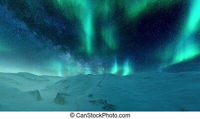 Northern Lights in night sky over winter landscape