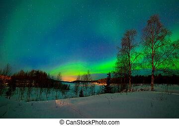 Intense northern lights - Aurora borealis over Lake in Finland
