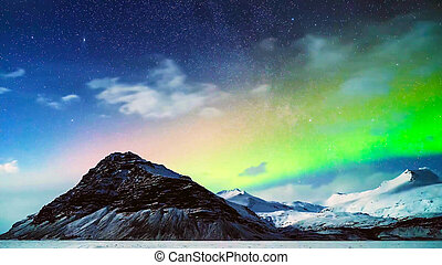 Northern lights near mountains and glaciers