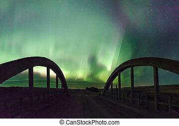 Northern Lights over a historic concrete bridge in Saskatchewan, Canada