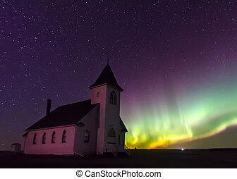 Northern Lights over a historical church in Saskatchewan