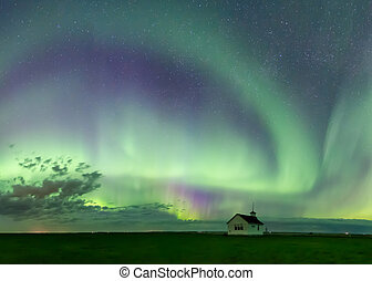 Northern Lights over a historical school in Saskatchewan