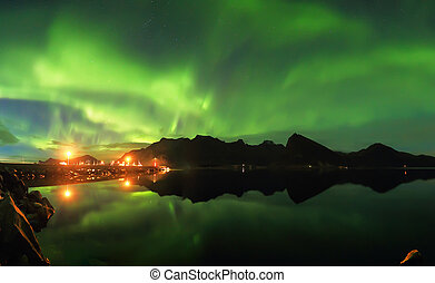 Northern lights over fjord