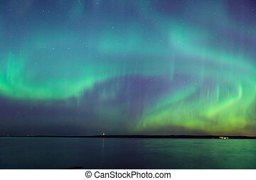 Northern lights over lake in finland