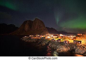 Northern lights over the Hamnoy village, Lofoten islands,...
