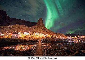 Northern lights over the Reine fishing village, Lofoten islands