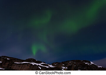 Northern lights over the rocks