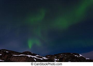 Northern lights over the rocks